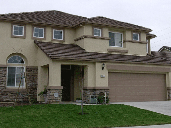 Stucco painting from kelowna painters i live to paint for Exterior finishes for homes
